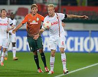 FUSSBALL   1. BUNDESLIGA  SAISON 2012/2013   7. Spieltag FC Augsburg - Werder Bremen          05.10.2012 Nicolas Fuellkrug (li, SV Werder Bremen) gegen Kevin Voigt (FC Augsburg)