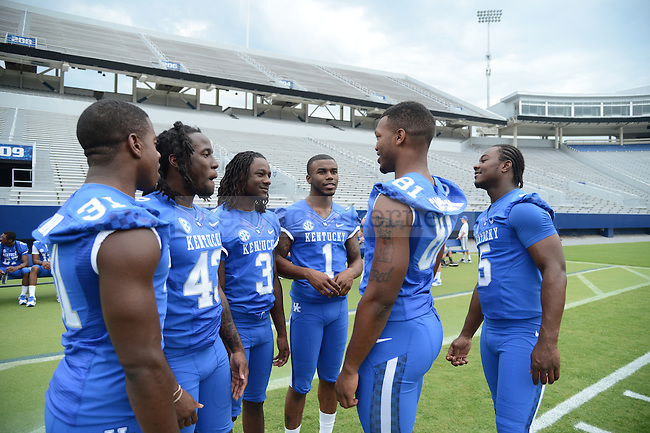 Freshman Rashad Cunningham (81) talks with fellow teammates at UK Football Media Day on Friday, August 3, 2012. Photo by Mike Weaver| Staff