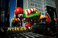 USA, New York, Nov 28, 2013. The Ronald McDonald balloon floats while people take part in the 87th Macy's Thanksgiving Day Parade in New York City. Photo by VIEWpress/Eduardo Munoz Alvarez