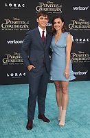 """HOLLYWOOD, CA - May 18: Brenton Thwaites, Chloe Pacey, At Premiere Of Disney's """"Pirates Of The Caribbean: Dead Men Tell No Tales"""" At Dolby Theatre In California on May 18, 2017. Credit: FS/MediaPunch"""