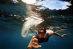 .Ilze Berzins, a fish veterinarian and biologist with the Florida Aquarium in Tampa, spots a jellyfish while snorkeling near Cayo Blanco, off CubaÕs southern coast. Within five to seven years the Cuban government says as much as 25 percent of its land and water will be contained in biological reserves. Erik Kellar