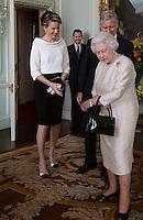 King Philippe & Queen Mathilde of Belgium meet with Queen Elisabeth II in Buckingham Palace - London