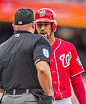 22 June 2014: Washington Nationals shortstop Ian Desmond has words with HP Umpire Mark Carlson during a game against the Atlanta Braves at Nationals Park in Washington, DC. The Nationals defeated the Braves 4-1 to split their 4-game series and take sole possession of first place in the NL East. Mandatory Credit: Ed Wolfstein Photo *** RAW (NEF) Image File Available ***