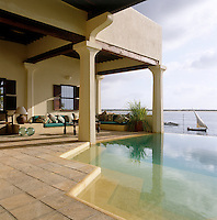 An horizon swimming pool within the central courtyard of the house with views over the beach and the stretch of water which separates Lamu from Manda Island