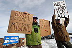 Biologists Cody Martz, left, and Taylor McKinnon hold protest signs at the Malheur National Wildlife Reserve on January 16, 2016 in Burns, Oregon.  Ammon Bundy and about 20 other protesters took over the refuge on Jan. 2 after a rally to support the imprisoned local ranchers Dwight Hammond Jr., and his son, Steven Hammond.      ©2016. Jim Bryant Photo. All Rights Reserved.