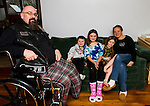 HARWINTON, CT - 31 DECEMBER 2016 - 123116JW02.jpg -- Dan DePaolo poses for a photo in his home with his children Jackson DePaolo age 6, Isabella  DePaolo age 9, Abigail  DePaolo age 7, and wife Cassandra DePaolo. A benefit is planned for DePaolo, who was one of many motorcycle riders injured in a motor vehicle accident that occured Sunday October 23rd, causing  him to have part of his leg amputated. Jonathan Wilcox Republican-American