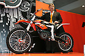 "Mar 26, 2010 - Tokyo, Japan - Harald Plöckinger of KTM Motorcycle AG poses with an electrically driven sports motorcycle called ""Freeride"" for offroad and supermoto riders during the 37th Tokyo Motorcycle Show at Tokyo Big Sight on March 26, 2010. This 'zero emission motorcycle' will go on sale on 2011, according to the Austrian company. (Photo Laurent Benchana/Nippon News)"