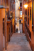 Narrow streets in the evening in the old town or Casc Antic of Tortosa, Tarragona, Spain. Tortosa is an ancient town situated on the Ebro Delta which has a rich heritage dating from Roman times. Picture by Manuel Cohen