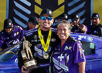 Sep 25, 2016; Madison, IL, USA; NHRA funny car driver Jack Beckman (left) celebrates with Terry Chandler and crew after winning the Midwest Nationals at Gateway Motorsports Park. Mandatory Credit: Mark J. Rebilas-USA TODAY Sports