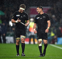 Sam Cane and Dan Carter of New Zealand have a word after the match. Rugby World Cup Semi Final between South Africa and New Zealand on October 24, 2015 at Twickenham Stadium in London, England. Photo by: Patrick Khachfe / Onside Images