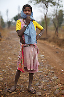 Adivasi (tribal) girl Atri Bai, 12, from the Baiga commumity in outside home village of Indripani. Atri Bai's family were relocated in 2002 from Bodhi Daldali to make way for the 668 hectare bauxite mine, run by Balco &amp; Vedanta (Vedanta is a UK headquartered company). Families received Rs.100,000 per acre of lost land. As many survived by cultivating forest land, this amount did not properly compensate them for their loss. The Bodhi Daldali mine directly employs just 70 people. 750 contractors, most of them casual day-wage workers, provide the labour without which the mine would not function. <br />