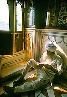 Sikh man praying inside the Golden Temple (the holiest Sikh shrine), Amritsar, Punjab, India