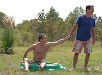 Man being playful with another man outdoors