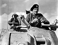 General Bernard L. Montgomery watches his tanks move up.  North Africa, November 1942.  British Official.  (OWI)<br /> Exact Date Shot Unknown<br /> NARA FILE #:  208-PU-138LL-3<br /> WAR &amp; CONFLICT BOOK #:  1017