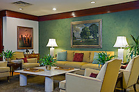 Eclectic blend of transitional, modern and antique with rich emerald green venetian plaster accent wall