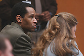 Sniper suspect John Allen Muhammad, left, listens to testimony along with attorney Christie Leary, right, during his trial in courtroom 10 at the Virginia Beach Circuit Court in Virginia Beach, Virginia on October 30, 2003. <br /> Credit: Adrin Snider - Pool via CNP