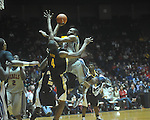 "Ole Miss guard Zach Graham (32)  is fouled by Southern Mississippi forward Gary Flowers (4) at C.M. ""Tad"" Smith Coliseum in Oxford, Miss. on Saturday, December 4, 2010."