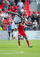 17 September 2011: Colorado Rapids defender Tyrone Marshall #34 and Toronto FC forward/midfielder Ryan Johnson #9 in action during an MLS game between the Colorado Rapids and the Toronto FC at BMO Field in Toronto, Ontario Canada..Toronto FC won 2-1.