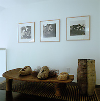 A collection of African masks displayed on a low wooden African table