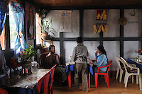 Locals enjoying food at a local resturant and bar in Central Bhutan. Arindam Mukherjee..