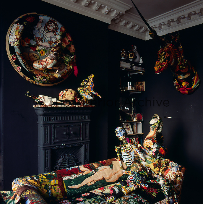 A corner of the living room in the apartment of artist Frederique Morrel. The apartment where she lives is also her studio and a reflection of her work. She works with tapestry to create animal heads, human figures and other objects