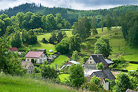 Giant Mountains, Northern Bohemia, Czech Republic, June 2010. The area around Teplice, also known as the Broumovsky Steny, was inhabited by ethnic Sudeten Germans, that were deported after the Second World War. The rural landscape with green fields and cattle is dotted with little villages scarred by communist socialist architecture. Photo by Frits Meyst/Adventure4ever.com