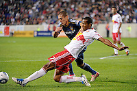 Bryan Jordan (27) of the Los Angeles Galaxy and Roy Miller (7) of the New York Red Bulls battle for the ball. The New York Red Bulls defeated the Los Angeles Galaxy 2-0 during a Major League Soccer (MLS) match at Red Bull Arena in Harrison, NJ, on October 4, 2011.