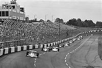 HAMPTON, GA - APRIL 22: Johnny Rutherford (#4 McLaren M24B/Cosworth TC) leads a group of cars into Turn #1 during the Gould Twin Dixie 125 event on April 22, 1979, at Atlanta International Raceway near Hampton, Georgia.