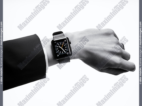 Woman wearing Apple Watch series 2 smartwatch on her wrist, closeup of hand isolated on white background in black and white