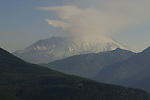 Mount St. Helens is most notorious for its catastrophic eruption on May 18, 1980, at 8:32 am PDT, the deadliest and most economically destructive volcanic event in the history of the United States. Fifty-seven people were killed; 250 homes, 47 bridges, 15 miles (24 km) of railways, and 185 miles (298 km) of highway were destroyed. A massive debris avalanche triggered by an earthquake measuring 5.1 on the Richter scale, caused an eruption, reducing the elevation of the mountain's summit from 9,677 ft (2,950 m) to 8,365 ft (2,550 m) and replacing it with a 1 mile (1.6 km) wide horseshoe-shaped crater.[3] The debris avalanche was up to 0.7 cubic miles (2.9 km3) in volume. The Mount St. Helens National Volcanic Monument was created to preserve the volcano and allow for its aftermath to be scientifically studied. As with most other volcanoes in the Cascade Range, Mount St. Helens is a large eruptive cone consisting of lava rock interlayered with ash, pumice, and other deposits. The mountain includes layers of basalt and andesite through which several domes of dacite lava have erupted. The largest of the dacite domes formed the previous summit, and off its northern flank sat the smaller Goat Rocks dome. Both were destroyed in the 1980 eruption. Jim Bryant Photo. ©2010. All Rights Reserved.