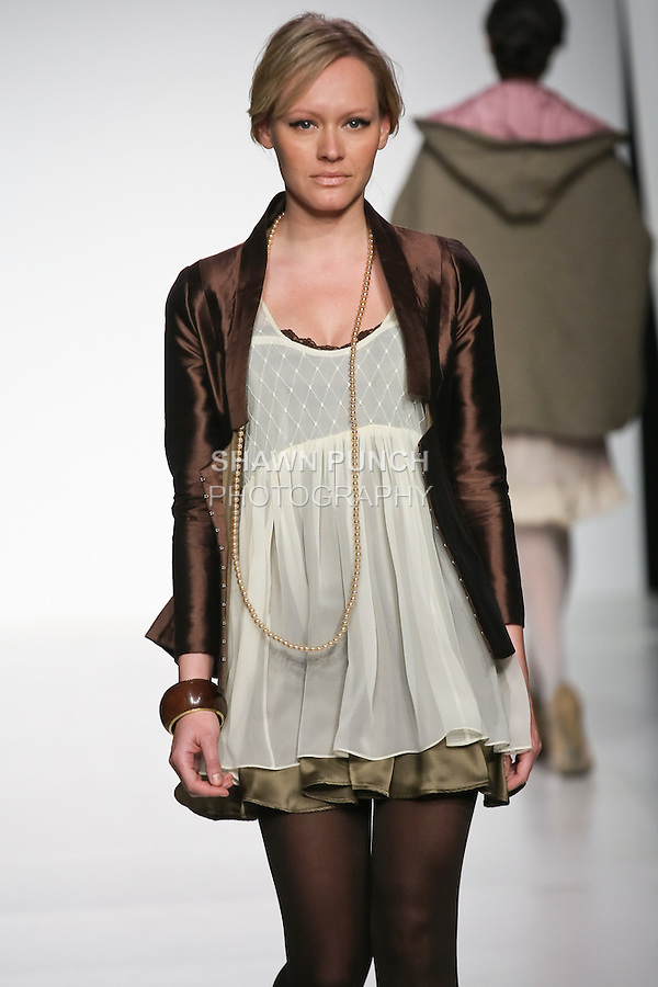 Model walks runway in an outfit from the Fontanelle collection by Maureen Flint, during the Pratt 2011 fashion show.