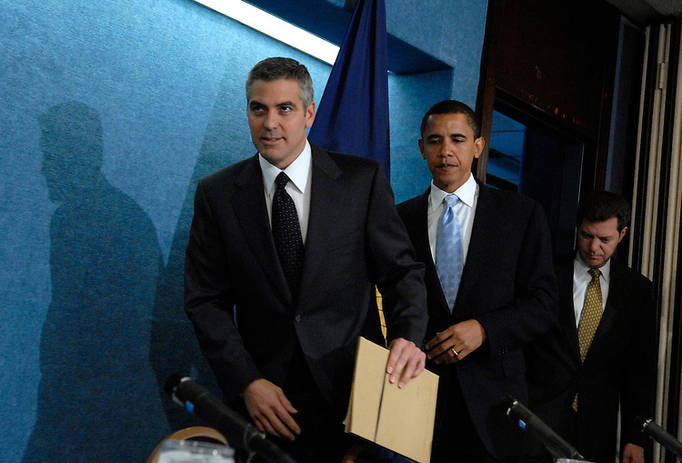 "Actor George Clooney, left, appeared at the National Press Club for ""SAVE DARFUR: Rally to Stop Genocide"" with Sens. Barack Obama, D-Ill., center, and Sam Brownback, R-Kan.  Clooney discussed he and his father's recent visit to the region"