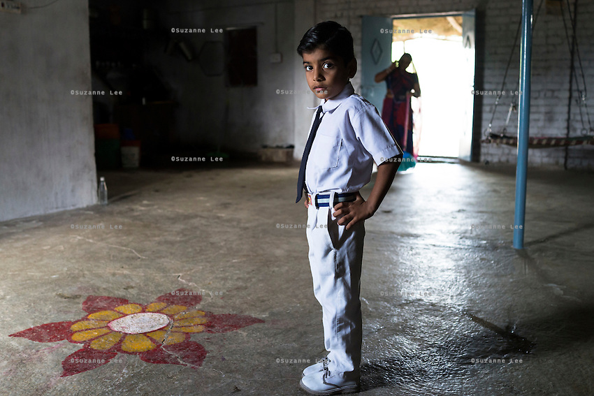 Hemant Jat, 6, gets ready for school at his home in Maheshwar, Khargone, Madhya Pradesh, India on 13 November 2014. Hemant, the son of Fairtrade cotton farmers, wants to be a police man when he grows up and gets a 5% discount of school fees at the Vasudha school. His parents would be happy if Hemant took over the farm but if he does well in school, he could look for other careers. Photo by Suzanne Lee for Fairtrade