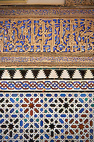 Arabesque Zellighe tiles with Mudjar plasterwork of the Alcazar of Seville, Seville, Spain