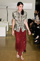 85 Broads member walks runway in an FW11 french fur trim blouse and FW11 burgundy silk chiffon ruffle skirt by Yuna Yang, during the 85 Broads Presents Yuna Yang trunk show at Art Gate Gallery on October 24th 2011.