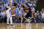 18 February 2017: Virginia's London Perrantes (32) guards North Carolina's Joel Berry II (left). The University of North Carolina Tar Heels hosted the University of Virginia Cavaliers at the Dean E. Smith Center in Chapel Hill, North Carolina in a 2016-17 Division I Men's Basketball game. UNC won the game 65-41.