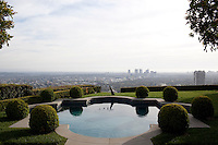 The pool, which is ringed with boxwood and features a kinetic sculpture by Peter Conze, overlooks downtown Los Angeles