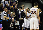 Wyoming's head coach Ben Jacobson looks at the time clock as his  players celebrate against Northern Iowa in their 2015 NCAA Division I Men's Basketball Championship March 20, 2015 at the Key Arena in Seattle, Washington.   Northern Iowa beat Wyoming 71 to 54.   ©2015.  Jim Bryant Photo. All Rights Reserved.