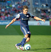 New England midfielder Ryan Guy (13) sends in a cross.  The Chicago Fire defeated the New England Revolution 3-2 at Toyota Park in Bridgeview, IL on Sept. 25, 2011.