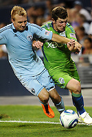 Michael Harrington (2) defender Sporting KC fights for the ball with Mike Fucito forward Seattle Sounders... Sporting Kansas City were defeated 1-2 by Seattle Sounders at LIVESTRONG Sporting Park, Kansas City, Kansas.