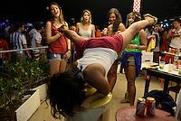 Young beautiful Brazilian women dance and have fun at a beach party during 2014 FIFA World Cup in Brazil, Copacabana beach, Rio de Janeiro.