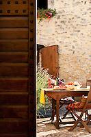 Dining in the romantic courtyard of 'I Cerri', 14th century Watch-tower of Poreta Castle, Spoleto, Umbria, Italy