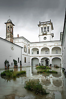 The ancient cloister of the converted convent after a rain storm