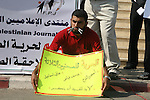 Palestinian journalists attend a protest calling for stop the violence against the journalists in front of the legislative council in Gaza City.