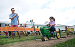 Bethlehem, CT- 13 September 2015-091315CM06- Juniper Philbrick 7, participates in the children's tractor pull as her dad, Kurtis Hall of Woodbury takes a photo during the Bethlehem Fair on Sunday. The weekend long fair concluded yesterday, marking 91 years since it's inception in 1924.    Christopher Massa Republican-American