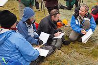 Artist Edward Rooks teaches a field drawing class on Westpoint Island, Falkland Islands