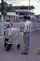 A friendly sidewalk ice cone vendor and customers in the town of Penonome, Cocle province, Panama