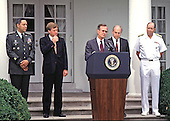 United States President George H.W. Bush names US Army General Colin Powell as Chairman, Joint Chiefs of Staff, at the White House on August 10, 1989 replacing US Navy Admiral William Crowe.  Left to Right: General Powell, Vice President Dan Quayle, President Bush, Defense Secretary Dick Cheney, and Admiral Crowe.<br /> Credit: Ron Sachs / CNP