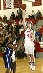 SOUTHBURY, CT, 01/02/08- 010208BZ12- Pomperaug's Derek Foy (42) goes to the hoop against Bunnell's Chris Rosario (12) during their game at Pomperaug High School in Southbury Wednesday night.<br /> Jamison C. Bazinet Republican-American