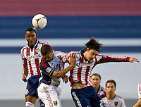 CARSON, CA - June 16, 2012: Chivas USA defender James Riley (7) and midfielder Ben Zemanski (21) and Real Salt Lake forward Alvaro Saborio (15) during the Chivas USA vs Real Salt Lake match at the Home Depot Center in Carson, California. Final score Real Salt Lake 3, Chivas USA 0.
